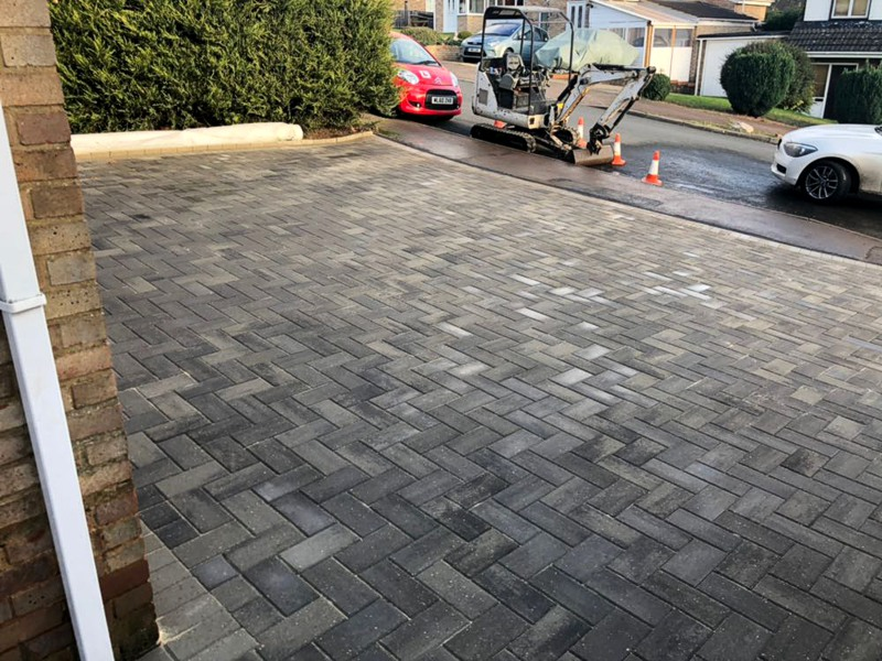 Block Paving is a highly durable surface ideal for parking cars on.